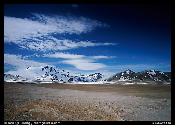 Snow-covered peaks surrounding the arid ash-covered floor of the Valley of Ten Thousand smokes. Katmai National Park (color)