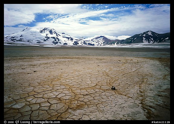 The desert-like floor of the Valley of Ten Thousand smokes is surrounded by snow-covered peaks such as Mt Meigeck. Katmai National Park (color)