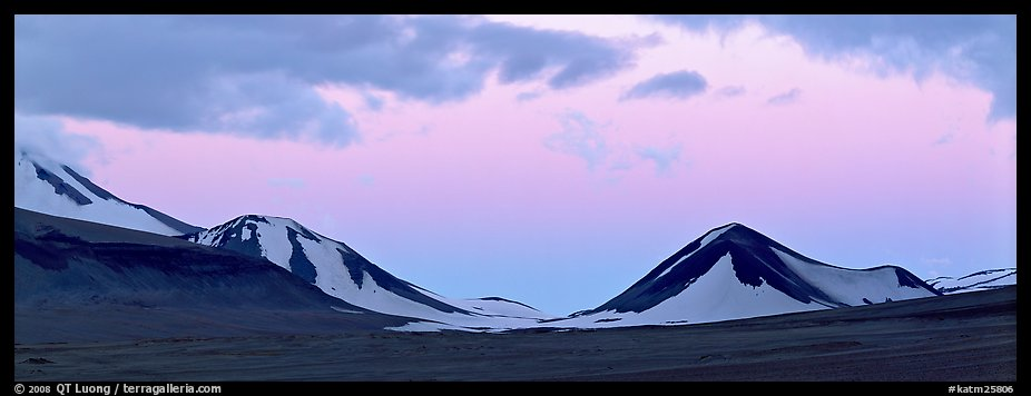 Snow-covered mountains with pink dusk sky. Katmai National Park (color)