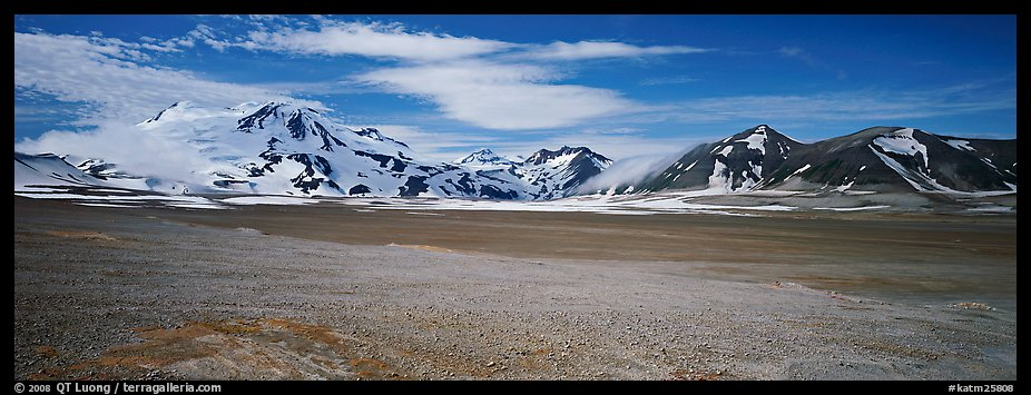 Snow-covered mountains contrasting with arid valley floor. Katmai National Park (color)