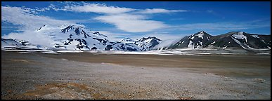 Snow-covered mountains contrasting with arid valley floor. Katmai National Park (Panoramic color)