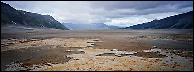 Arid ash plain landscape with colorful deposits. Katmai National Park (Panoramic color)