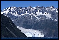 Aialik Glacier, fjord,  and steep mountains. Kenai Fjords National Park, Alaska, USA.
