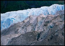 Grey ice, blue ice, Exit Glacier and forest. Kenai Fjords National Park, Alaska, USA.