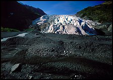Dark glacial plain floor and Exit Glacier. Kenai Fjords National Park, Alaska, USA.