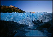 Front of Exit Glacier, sunrise and moon. Kenai Fjords National Park, Alaska, USA.