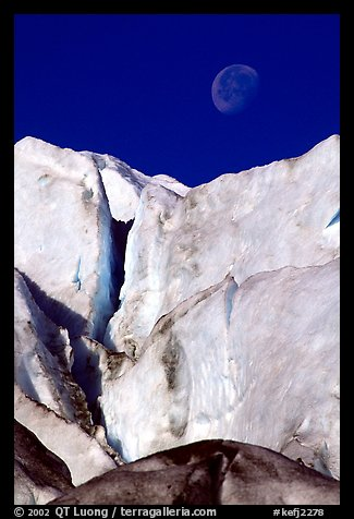 Seracs of Exit Glacier and moon. Kenai Fjords National Park, Alaska, USA.