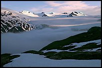 Low clouds, partly melted snow cover, and mountains. Kenai Fjords National Park, Alaska, USA. (color)