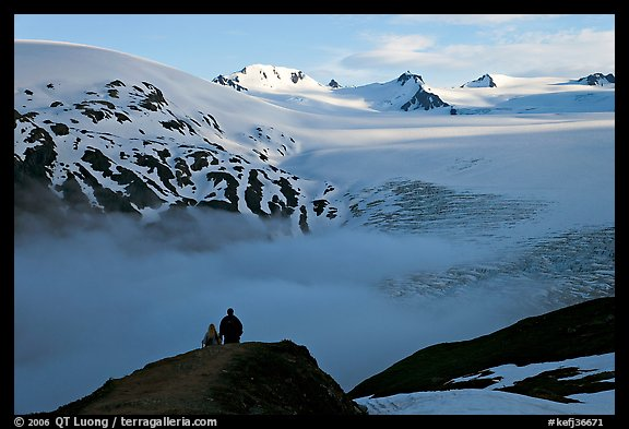 Two people hiking down Harding Ice Field trail. Kenai Fjords National Park, Alaska, USA.