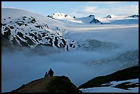 Two people hiking down Harding Ice Field trail. Kenai Fjords National Park, Alaska, USA. (color)
