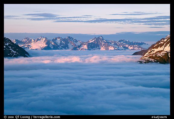 Resurrection Mountains emerging from clouds at sunset. Kenai Fjords National Park (color)