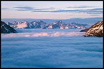 Resurrection Mountains emerging from clouds at sunset. Kenai Fjords National Park, Alaska, USA. (color)