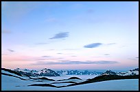 Pastel sky, mountain ranges and sea of clouds at dusk. Kenai Fjords National Park, Alaska, USA.