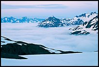 Mountains above low fog at dusk. Kenai Fjords National Park, Alaska, USA.