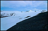 Rocky slope and snow-covered Harding Icefield at dusk. Kenai Fjords National Park, Alaska, USA. (color)