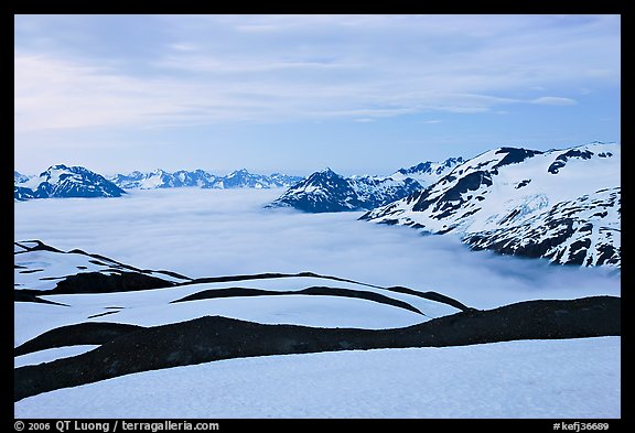 Dark bands of freshly uncovered terrain, snow, and low clouds, dusk. Kenai Fjords National Park (color)