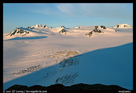 Snow-covered glacier and Harding Ice field peaks, sunrise. Kenai Fjords National Park, Alaska, USA.