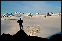 Man standing on overlook above Harding ice field, early morning. Kenai Fjords National Park, Alaska, USA. (color)