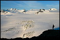 Harding icefield with man standing in the distance. Kenai Fjords National Park, Alaska, USA.