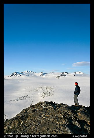 Hiker looking at the Harding icefield. Kenai Fjords National Park (color)