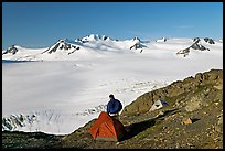 Tent and backpacker above the Harding icefield. Kenai Fjords National Park, Alaska, USA.