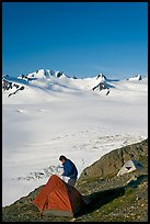 Camper exiting tent above the Harding ice field. Kenai Fjords National Park ( color)