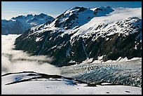 Peaks, glacier, and sea of clouds, morning. Kenai Fjords National Park, Alaska, USA.
