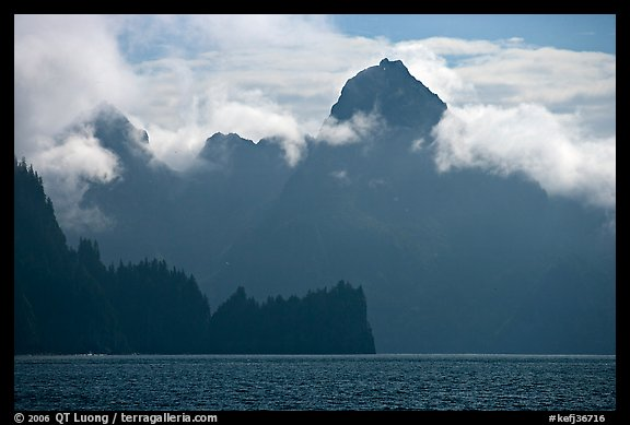 Peak emerging from the fog above bay waters. Kenai Fjords National Park (color)