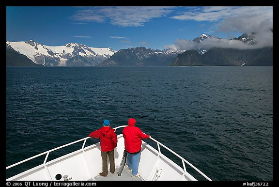 Passengers with red jackets on bow of tour boat, Northwestern Fjord. Kenai Fjords National Park (color)