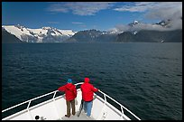 Passengers with red jackets on bow of tour boat, Northwestern Fjord. Kenai Fjords National Park, Alaska, USA.