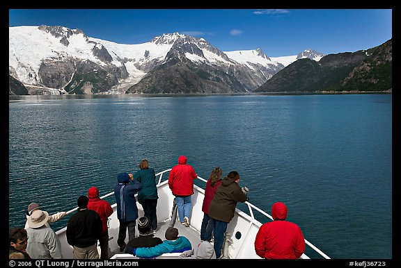 Vistors on bow of tour boat approaching glacier, Northwestern Fjord. Kenai Fjords National Park (color)