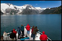 Vistors on bow of tour boat approaching glacier, Northwestern Fjord. Kenai Fjords National Park, Alaska, USA. (color)