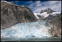 Northwestern tidewater glacier and steep cliffs, Northwestern Fjord. Kenai Fjords National Park, Alaska, USA.