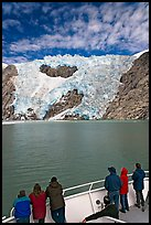 People watch  Northwestern glacier from deck of boat, Northwestern Lagoon. Kenai Fjords National Park, Alaska, USA.
