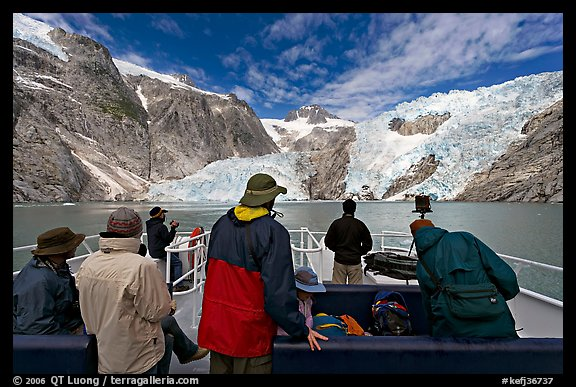 Passengers on the deck of tour boat and Northwestern glacier, Northwestern Lagoon. Kenai Fjords National Park (color)