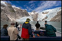 Passengers on the deck of tour boat and Northwestern glacier, Northwestern Lagoon. Kenai Fjords National Park, Alaska, USA.