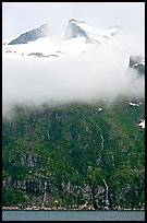 Cloud-covered peak and waterfalls, Northwestern Fjord. Kenai Fjords National Park, Alaska, USA.