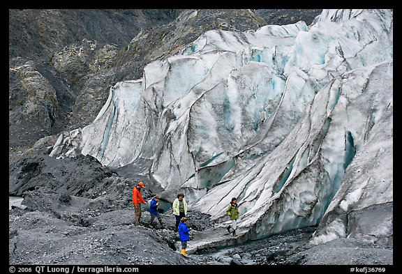 Family hiking on moraine at the base of Exit Glacier. Kenai Fjords National Park (color)
