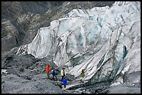 Family hiking on moraine at the base of Exit Glacier. Kenai Fjords National Park, Alaska, USA.