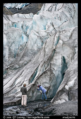 Couple checking out the ice at the terminus of Exit Glacier. Kenai Fjords National Park (color)