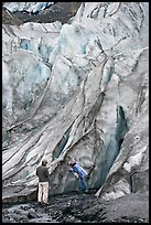 Couple checking out the ice at the terminus of Exit Glacier. Kenai Fjords National Park, Alaska, USA. (color)