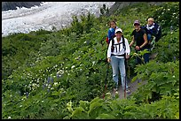 Women carrying infants on trail. Kenai Fjords National Park, Alaska, USA.