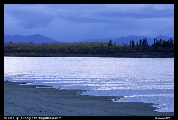 Sand bar shore, bright river and Baird mountains, evening. Kobuk Valley National Park (color)