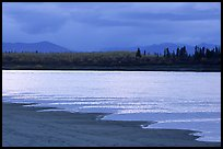 Sand bar shore, bright river and Baird mountains, evening. Kobuk Valley National Park, Alaska, USA. (color)