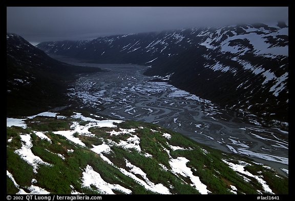 Aerial view of Tikakila River valley under dark clouds. Lake Clark National Park (color)