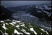 Aerial view of Tikakila River valley under dark clouds. Lake Clark National Park, Alaska, USA. (color)