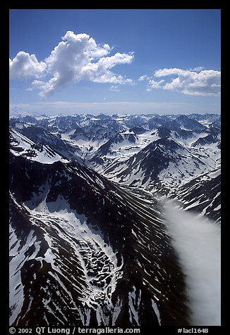 Aerial view of rocky peaks with snow, Chigmit Mountains. Lake Clark National Park, Alaska, USA.