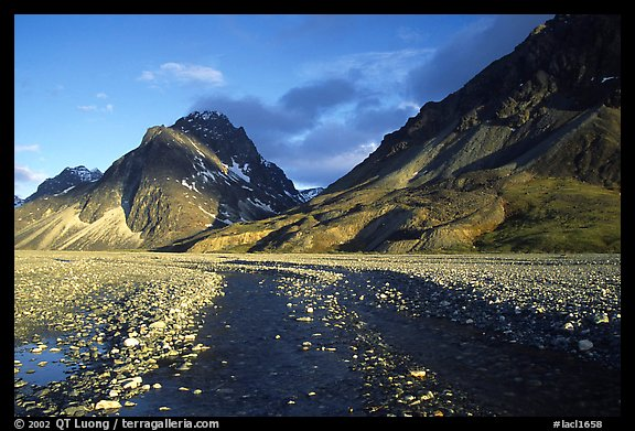 Wide gravel river bar below the Telaquana Mountains, sunset. Lake Clark National Park (color)