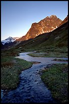 Stream on plain  below the Telaquana Mountains, late afternoon. Lake Clark National Park, Alaska, USA.