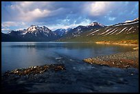 Stream flowing into Turquoise Lake, sunset. Lake Clark National Park, Alaska, USA.